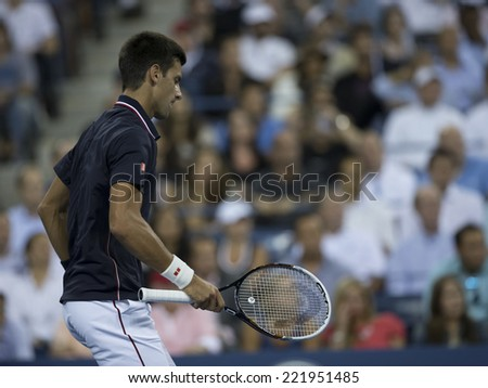 NEW YORK, NY - SEPTEMBER 3, 2014: Novak Djokovic of Serbia reacts during quarterfinal match against Andy Murray of United Kingdom at US Open championship in Flushing Meadows USTA Tennis Center - stock photo
