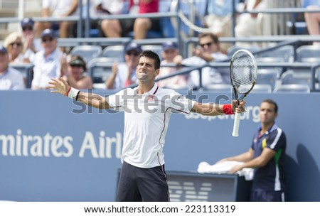 NEW YORK, NY - SEPTEMBER 1, 2014: Novak Djokovic of Serbia reacts during 4th round match against Phillipp Kphlschreiber of Germany at US Open in Flushing Meadows USTA Tennis Center - stock photo