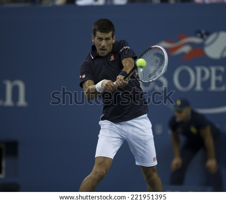 NEW YORK, NY - SEPTEMBER 3, 2014: Novak Djokovic of Serbia returns ball during quarterfinal match against Andy Murray of United Kingdom at US Open championship in Flushing Meadows USTA Tennis Center - stock photo