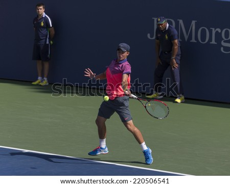 NEW YORK, NY - SEPTEMBER 7, 2014: Omar Jasika ofAustralia retruns ball during final boys juniors match against Quentin Halys of France at US Open championship in Flushing Meadows USTA Tennis Center - stock photo