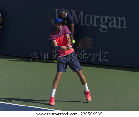NEW YORK, NY - SEPTEMBER 7, 2014: Quentin Halys of France retruns ball during final boys juniors match against Omar Jasika ofAustralia at US Open championship in Flushing Meadows USTA Tennis Center - stock photo
