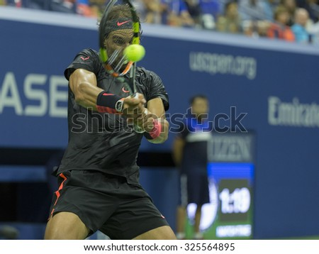 New York, NY - September 4, 2015: Rafael Nadal of Spain returns ball during 3rd round match against Fabio Fognini of Italy at US Open Championship - stock photo