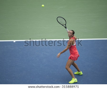 New York, NY - September 12, 2015: Roberta Vinci of Italy returns ball during final match against Flavia Pennetta of Italy at US Open Championship - stock photo