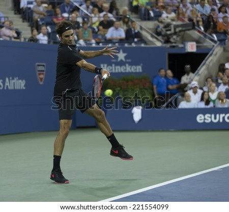 NEW YORK, NY - SEPTEMBER 4, 2014: Roger Federer of Switzerland returns ball during quarterfinal match against Gael Monfils of France at US Open championship in Flushing Meadows USTA Tennis Center - stock photo