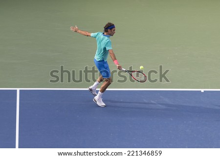 NEW YORK, NY - SEPTEMBER 6, 2014: Roger Federer of Switzerland returns ball during semifinal match against Marin Cilic of Croatia at US Open championship in Flushing Meadows USTA Tennis Center - stock photo