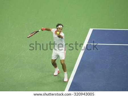 New York, NY - September 13, 2015: Roger Federer of Switzerland serves against Novak Djokovic of Serbia during final of US Open Championship at Ash stadium - stock photo