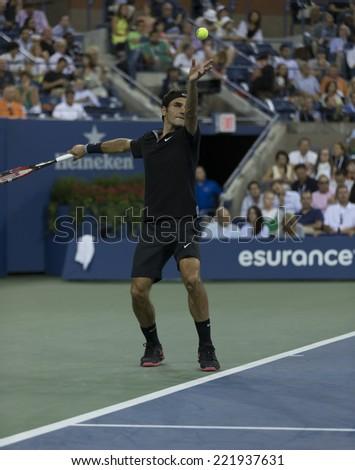 NEW YORK, NY - SEPTEMBER 4, 2014: Roger Federer of Switzerland serves ball during quarterfinal match against Gael Monfils of France at US Open championship in Flushing Meadows USTA Tennis Center - stock photo