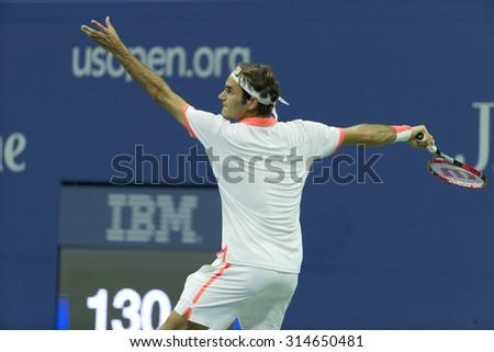 New York, NY - September 7, 2015: Roger Federer of Switzerland serves during 4th round match against  John Isner of USA at US Open Championship - stock photo