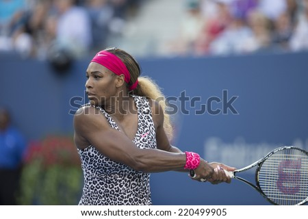NEW YORK, NY - SEPTEMBER 7, 2014: Serena WIlliams of USA returns ball during final match against Caroline Wozniacki of Denmark at US Open championship in Flushing Meadows USTA Tennis Center - stock photo