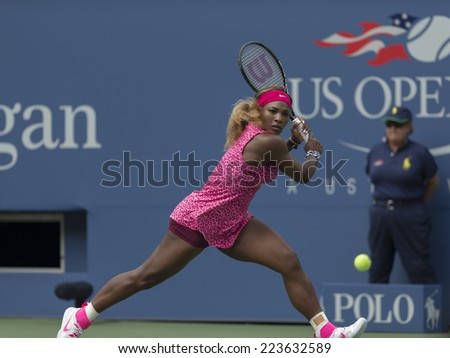NEW YORK, NY - SEPTEMBER 1, 2014: Serena Williams of USA returns ball during 4th round match against Kaia Kanepi of Estonia at US Open in Flushing Meadows USTA Tennis Center - stock photo