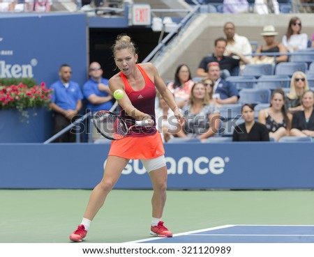 New York, NY - September 11, 2015: Simona Halep of Romania returns ball during semifinal against Flavia Pennetta of Italy at US Open Championship on Ash stadium - stock photo