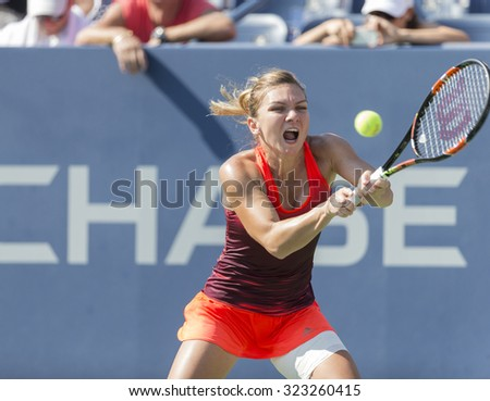 New York, NY - September 7, 2015: Simona Halep of Romania returns ball during 4th round match against Sabine Lisicki of Germany at US Open Championship - stock photo