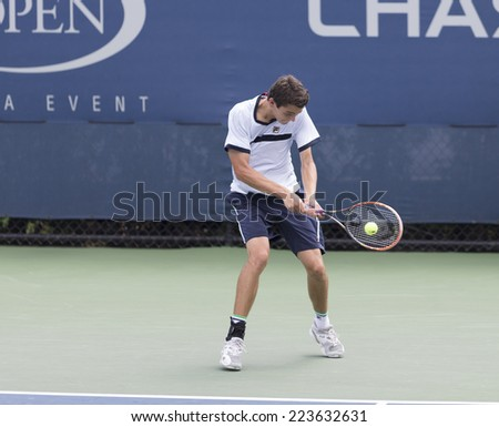NEW YORK, NY - SEPTEMBER 1, 2014: Taylor Harry Fritz of USA returns ball during 1st round junior boys match against Tim Van Rijhoven of Netherland at US Open in Flushing Meadows USTA Tennis Center