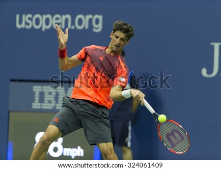 New York, NY - September 5, 2015: Thomaz Bellucci of Brazil returns ball during 3rd round match against Andy Murray of Great Britain at US Open Championship - stock photo