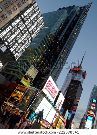 NEW YORK, NY - SEPTEMBER 17, 2014: Times Square in New York City is filled with tall buildings and advertising for many services including retail clothing chains, Broadway plays, electronics, etc. - stock photo