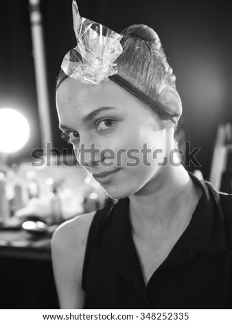 New York, NY - September 12, 2015: Vera Vavrova prepares backstage for the Monique Lhuillier Spring 2016 fashion show during New York Fashion Week at The Arc - Skylight Moynihan Station - stock photo