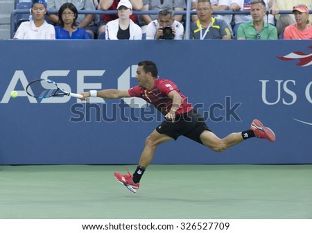 New York, NY - September 1, 2015: Victor Estrella Burgos of Dominican Republic returns ball during 1st round match against Jack Sock of USA  at US Open Championship - stock photo