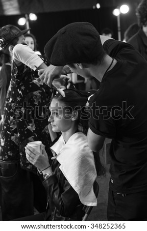 New York, NY - September 12, 2015: Yulia Ermakova prepares backstage for the Monique Lhuillier Spring 2016 fashion show during New York Fashion Week at The Arc - Skylight Moynihan Station - stock photo