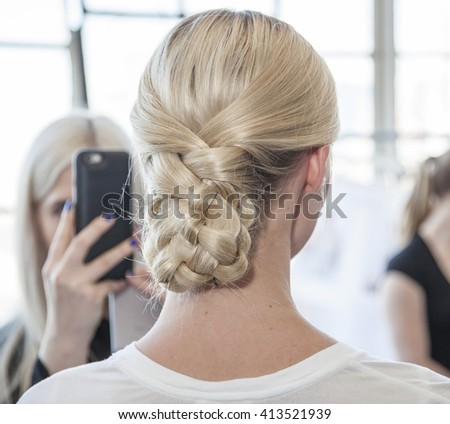 New York, NY, USA - April 13, 2016: A model prepares backstage for Marchesa Spring/Summer 2017  Bridal Presentation at Canoe Studio, Manhattan - stock photo