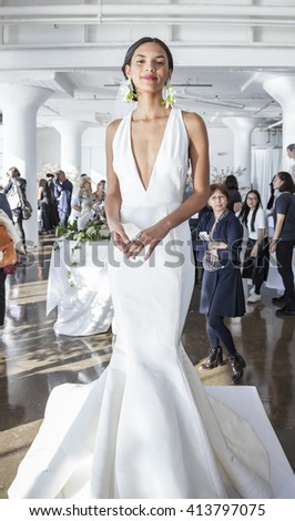 New York, NY, USA - April 13, 2016: A model shows up a wedding dress for Marchesa Spring/Summer 2017 Bridal Presentation at Canoe Studio, Manhattan