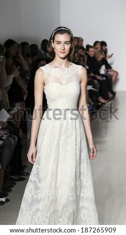 New York, NY, USA - April 12, 2014: A model walks the runway for the Christos collection by Amsale during New York International Bridal Week at the EZ-Studios, Manhattan