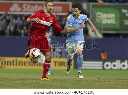 New York, NY USA - April 10, 2016: David Villa (7) of NYC FC fights for ball with Jonathan Campbell (16) of Chicago Fire during MLS soccer game against Chicago Fire at Yankee stadium