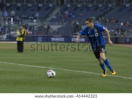 New York, NY USA - April 27, 2016:Maxim Tissot  (51) of Montreal Impact performs free kick during MLS game NYC FC against Montreal Impact at Yankee Stadium - stock photo