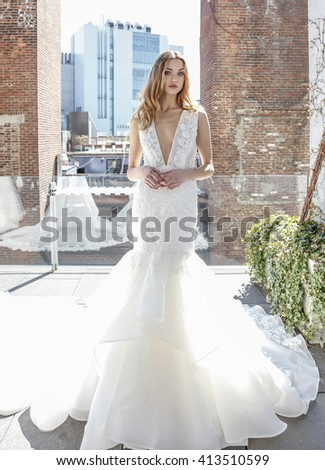 New York, NY, USA - April 15, 2016: Model shows up wedding dress for RIVINI & Alyne Spring 2017 Bridal Collection by Rita Vinieris at The Standard, High Line during New York International Bridal week - stock photo