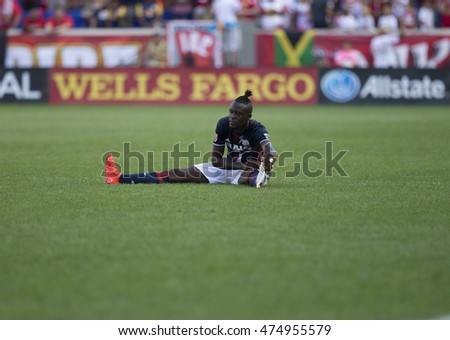 New York, NY USA - August 28, 2016: Kei Kamara (13) of New England Revolution relaxes during MLS game against New York Red Bulls on Red Bull arena. Red Bulls won 1 - 0