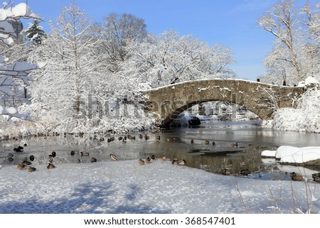NEW YORK, NY, USA-FEB 4: Central Park, bridge with snow, frozen pond, February 3, 2014