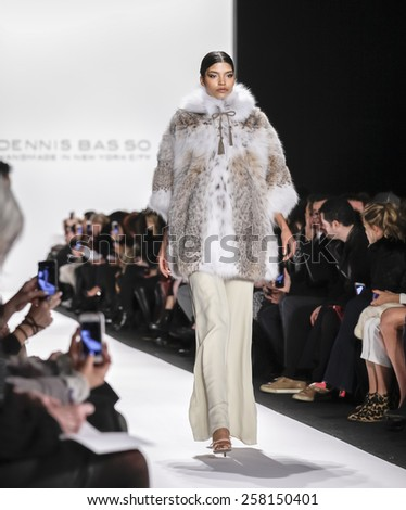New York, NY, USA - February 16, 2015: A model walks runway for Dennis Basso Fall 2015 Runway show during Mercedes-Benz Fashion Week New York at the Theatre at Lincoln Center, Manhattan - stock photo
