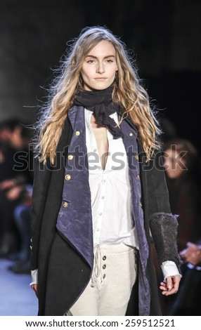 New York, NY, USA - February 18, 2015: A model walks runway for Greg Lauren Fall/Winter 2015 collection during Mercedes-Benz Fashion Week New York at the ARTBEAM, Manhattan - stock photo