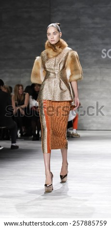 New York, NY, USA - February 14, 2015: A model walks runway for Son Jung Wan Fall 2015 Runway show during Mercedes-Benz Fashion Week New York at the Pavilion at Lincoln Center, Manhattan - stock photo