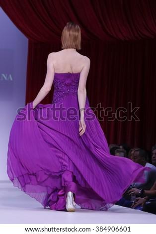 New York, NY, USA - February 14, 2016: A model walks the runway at the Farah Angsana runway show during of Fall/Winter 2016 New York STYLE Fashion Week at Gotham Hall, Manhattan. - stock photo