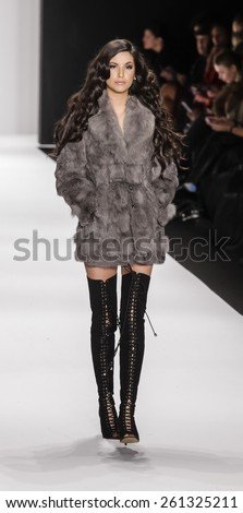 New York, NY, USA - February 19, 2015: Model walks runway for Mimi Tran Fall 2015 collection at Art Hearts Fashion Presented By AHF during Mercedes-Benz Fashion Week at The Theatre at Lincoln Center