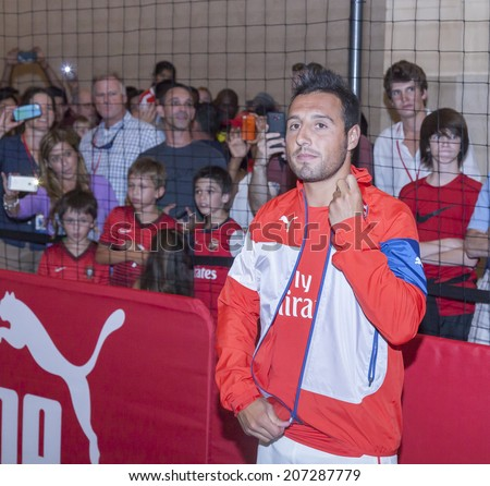 New York, NY, USA - July 25, 2014: Arsenal  football player Santi Cazorla attends the PUMA partners with Arsenal Football Club to Debut Monumental Cannon event in Grand Central Station in NYC - stock photo