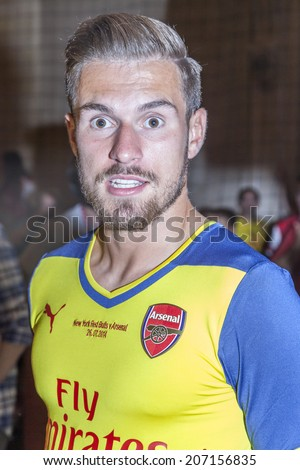 New York, NY, USA - July 25, 2014: Arsenal player Aaron Ramsey attends the PUMA partners with Arsenal Football Club to Debut Monumental Cannon event  in Grand Central Station in New York City. - stock photo