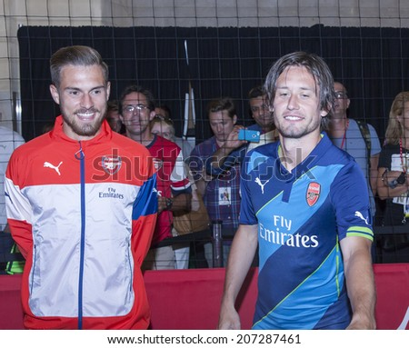 New York, NY, USA - July 25, 2014: (L-R) Footballers Aaron Ramsey and Tomas Rosicky greet fans at PUMA partners w/Arsenal Football Club to Debut Monumental Cannon event in Grand Central Station in NYC - stock photo