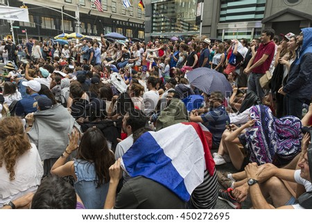 New York, NY USA - July 10, 2016: People watch Euro 2016 soccer final between France and Portugal during Bastille Day celebration on 60th street in Manhattan - stock photo