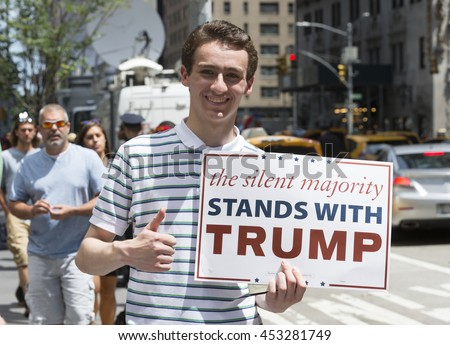 New York, NY USA - July 16, 2016: Young Trump supporter stands outside of Hilton hotel Midtown Manhattan during Donald Trump introduction Governor Mike Pence as running for vice president