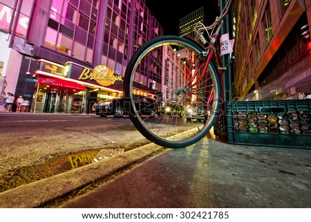 NEW YORK, NY, USA - June 12, 2015: Low angle of New York's busy 42nd Street off Times Square showing a bike and the Brooklyn Diner - stock photo