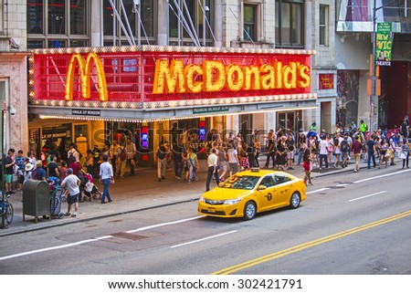 NEW YORK, NY, USA - June 12, 2015: The worlds biggest burger chain McDonald's restaurant on busy 42nd Street in New York City crowded with people - stock photo