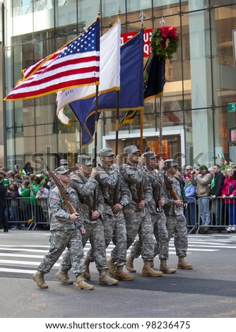 NEW YORK, NY, USA MAR 17: Marching US miltary soldiers from the 69th Infantry at the St. Patrick's Day Parade on March 17, 2012 in New York City, United States. - stock photo