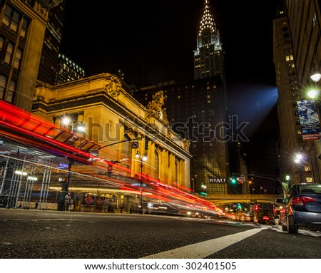 NEW YORK, NY, USA - MAR 17, 2014: Traffic outside Grand Central Terminal at night on 42nd Street in New York City - stock photo