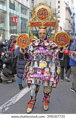New York, NY USA- March 27, 2016: Man in full costume stops to pose for spectators along Fifth Avenue during the Easter Bonnet Parade in New York City.  - stock photo