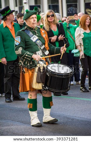 New York, NY, USA - March 17, 2016: Marchers with bagpipes dressed in kilts march in the St Patrick's Day Parade on on 5th Ave in New York City. - stock photo