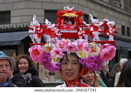 New York, NY USA- March 27, 2016: Woman wears decorated hat during Easter bonnet Parade.  - stock photo