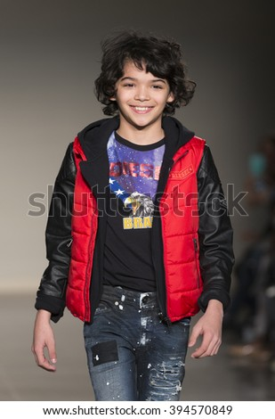 New York, NY USA - March 12, 2016: Young model walks runway for Diesel Kids during petiteParade fashion show at Spring studios - stock photo