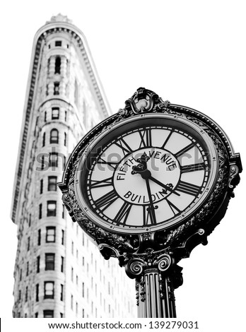 NEW YORK, NY, USA - MAY 6: Flat Iron building, built in 1902 is of the first skyscrapers ever built and one of New York's famous sidewalk clocks on May 6, 2012 in New York City, United States.  - stock photo