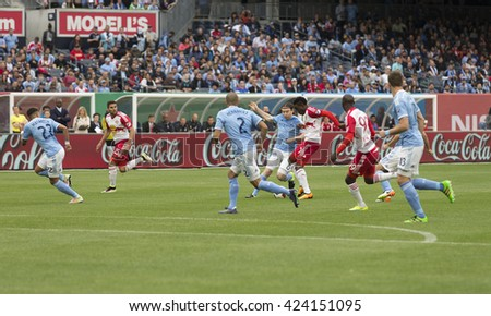 New York, NY USA - May 21, 2016: Lloyd Sam (10) of Red Bulls fights for ball at MLS game NYC FC against Red Bulls at Yankee stadium. Red Bulls won 7-0